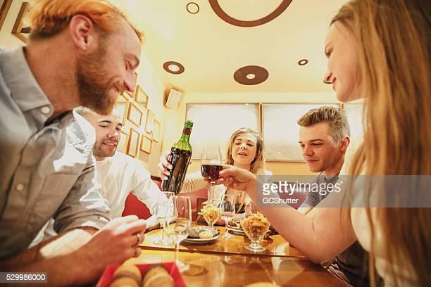 Friends having celebration at a cafe