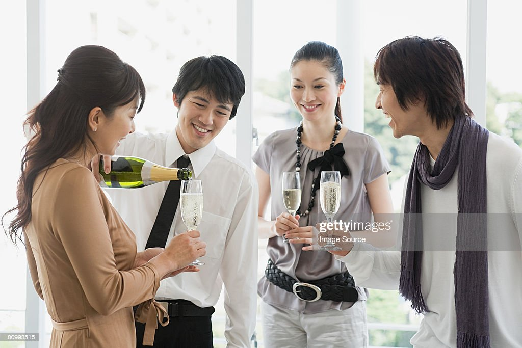 Friends having champagne : Stock Photo