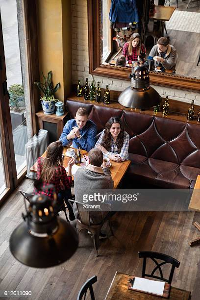 Friends having coffee in cafe