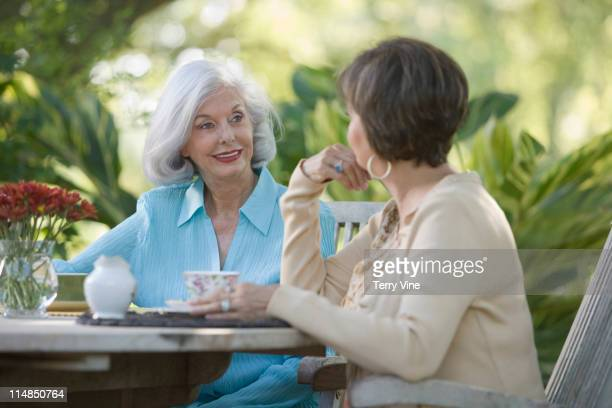 Friends having coffee on patio