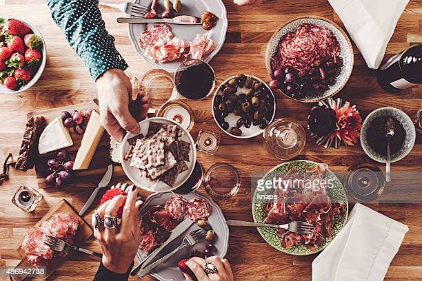 friends having dinner overhead table top view - tapas stock photos and pictures