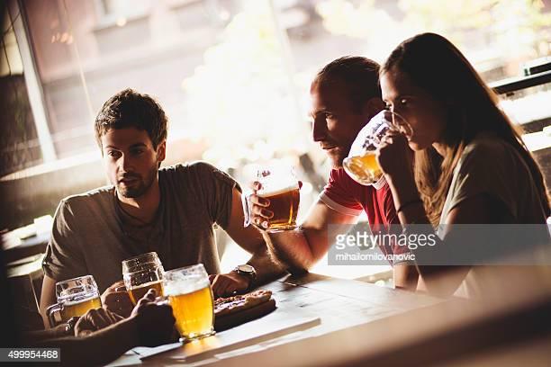 Friends having drink in a bar