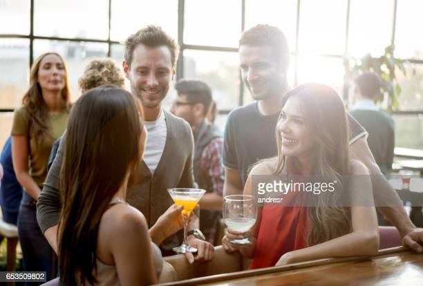Friends having drinks at a bar