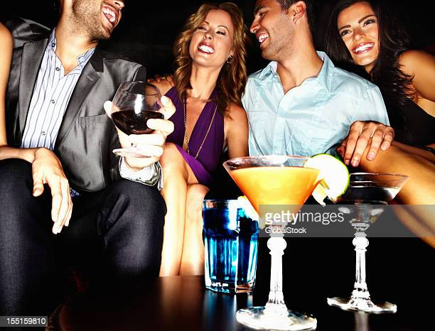 Friends having drinks at a club
