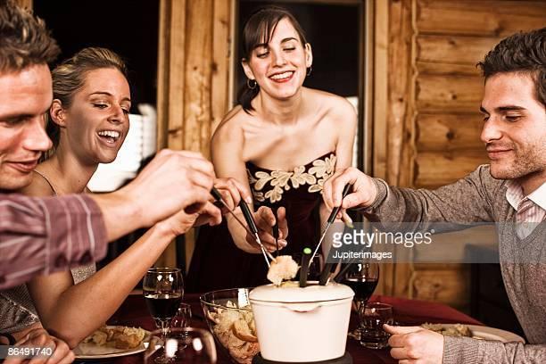 Friends having fondue
