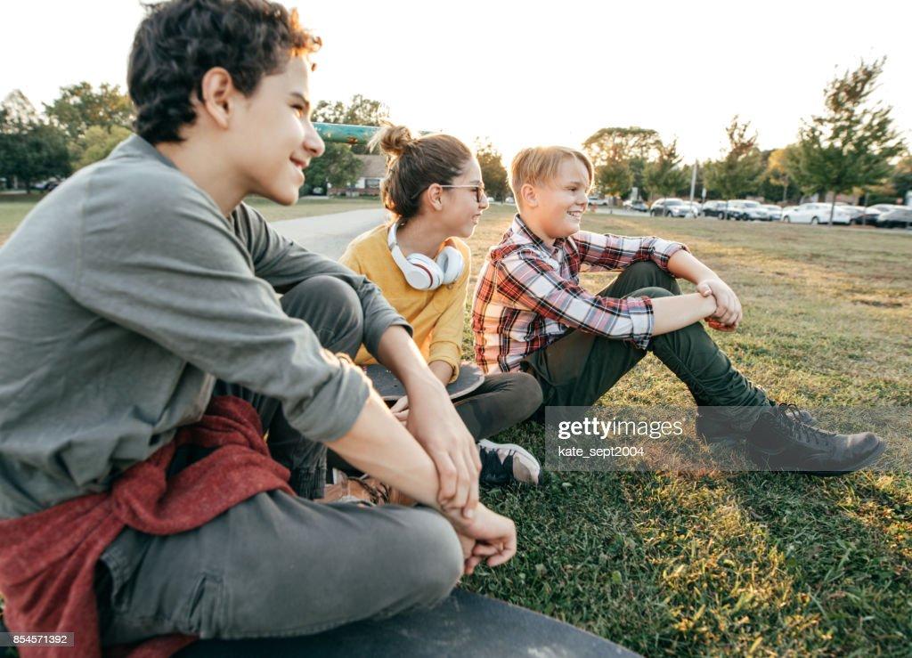 Friends having fun after school : Stock Photo