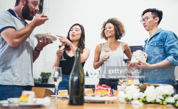 Friends having fun and enjoying cake.