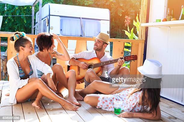 Friends having fun and flirting on sunny pavilion