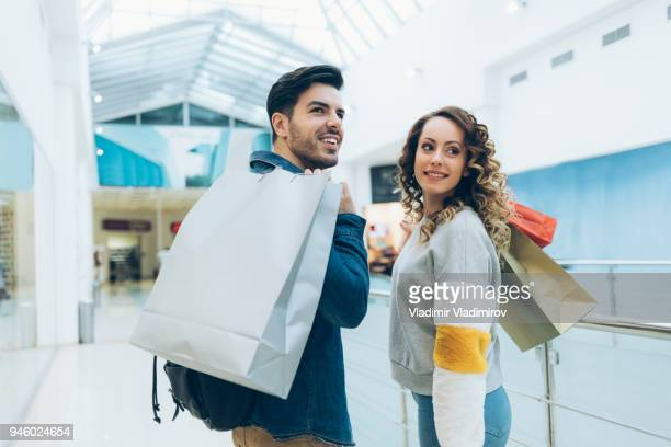 Friends having fun and shopping in mall