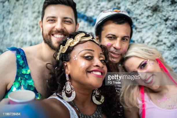 friends having fun and taking a selfie at carnival party in brazil - mardi gras stock pictures, royalty-free photos & images