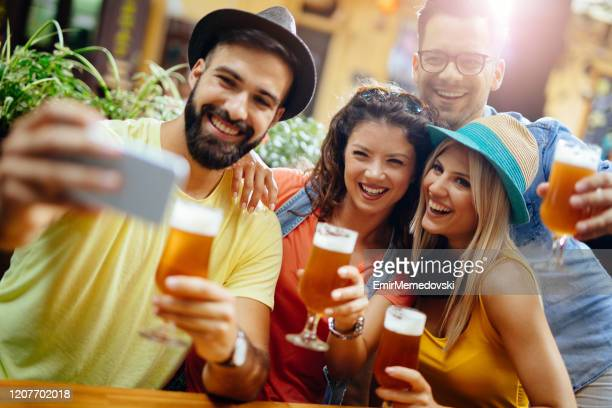 friends having fun and taking selfie in a fast food restaurant - emir memedovski stock pictures, royalty-free photos & images