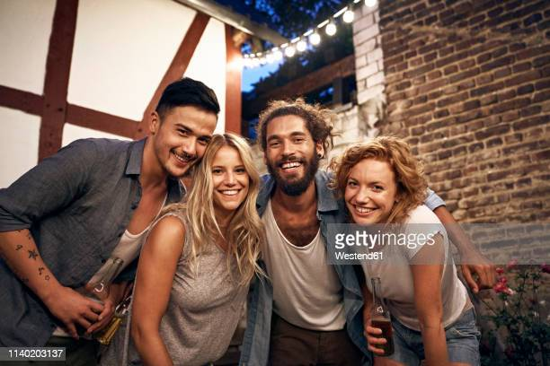 friends having fun at a backyard party - four people stock pictures, royalty-free photos & images