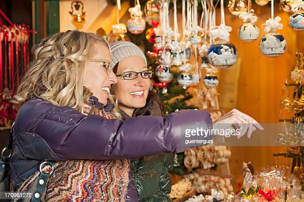 Friends having fun at a Christmas Market in Europe