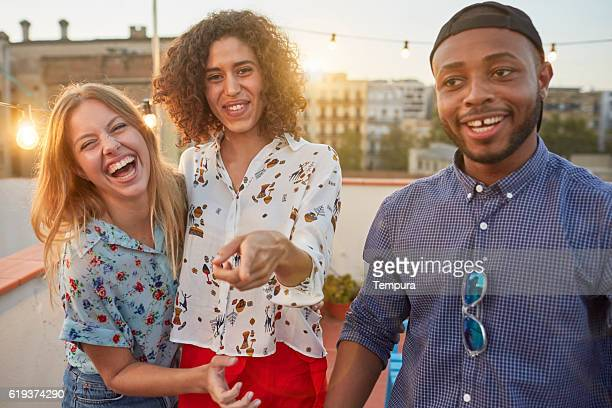 Friends having fun at a rooftop party.