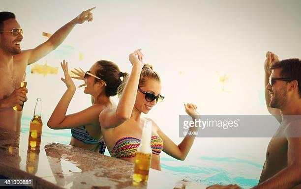 Friends having fun at beach bar.