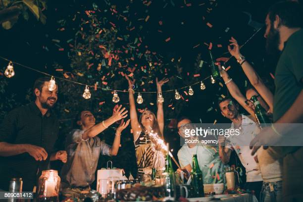 friends having fun at birthday party - birthday party stock pictures, royalty-free photos & images
