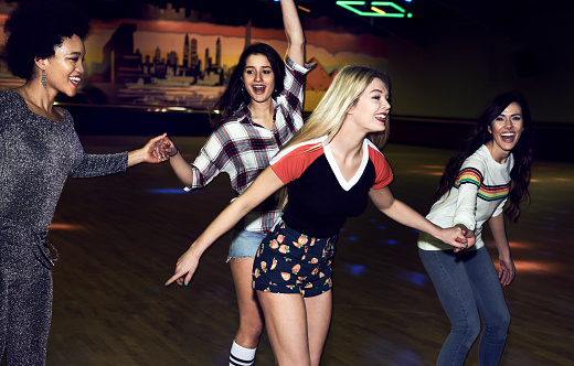 Friends having fun at roller disco - gettyimageskorea