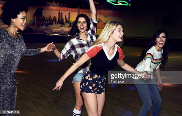 Friends having fun at roller disco
