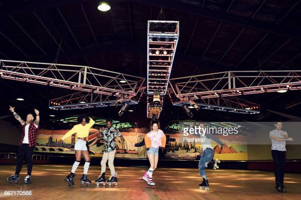 friends having fun at roller disco - roller rink stock photos and pictures