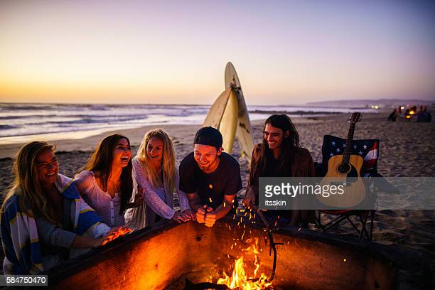 friends having fun at san diego beach - fire pit stock pictures, royalty-free photos & images
