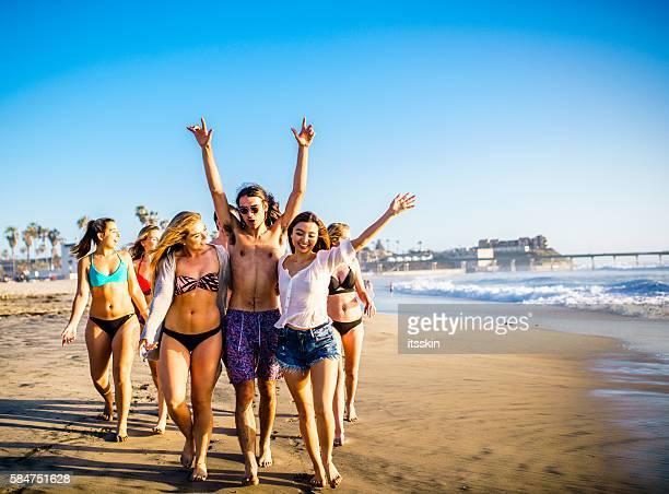 Friends having fun at San Diego beach
