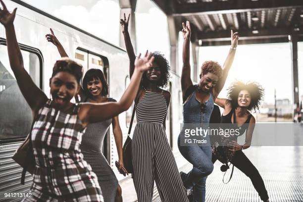 friends having fun at subway station - black women stock photos and pictures