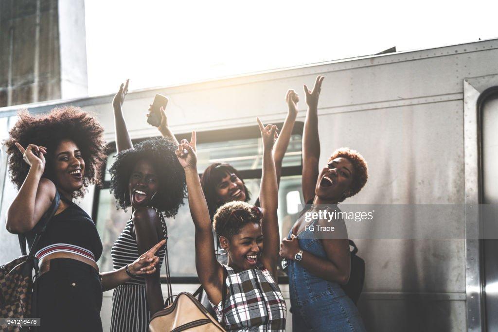Friends Having Fun at subway station : Stock Photo