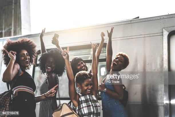 friends having fun at subway station - funny black girl stock photos and pictures