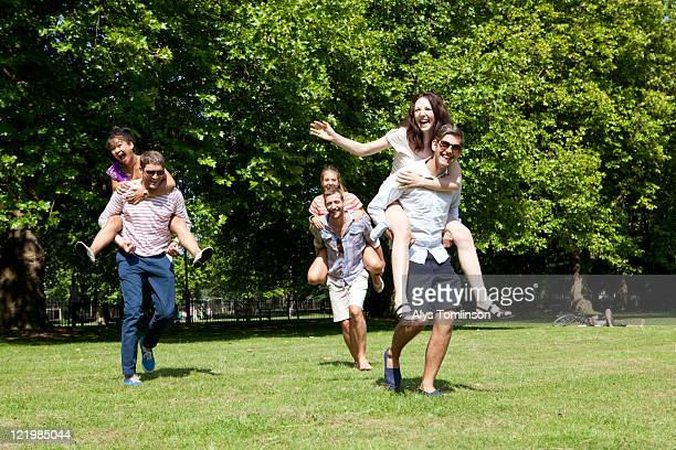 friends having fun in a city park - park city stock photos and pictures