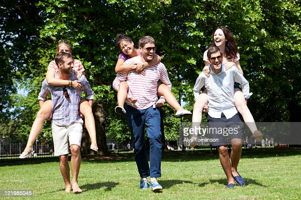 friends having fun in a city park - medium group of people stock pictures, royalty-free photos & images