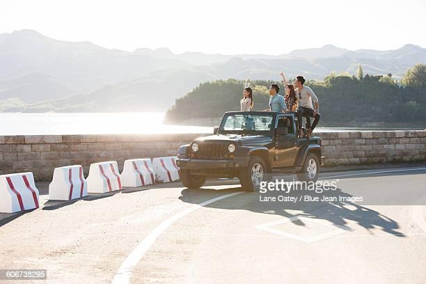 Friends having fun in a jeep