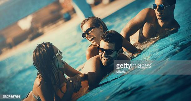 Friends having fun in a swimming pool.