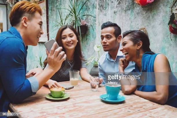 friends having fun in kuala lumpur cafe - different cultures stock pictures, royalty-free photos & images