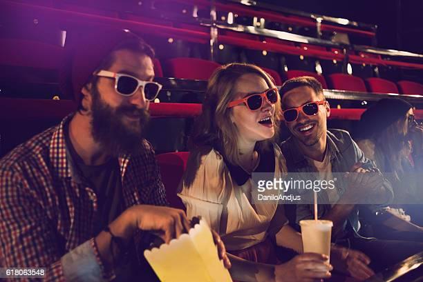 friends having fun in movie theater