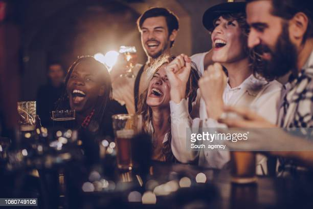 friends having fun in pub - ale stock pictures, royalty-free photos & images