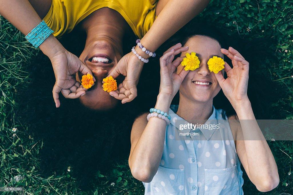 Friends having fun in the park : Stock Photo