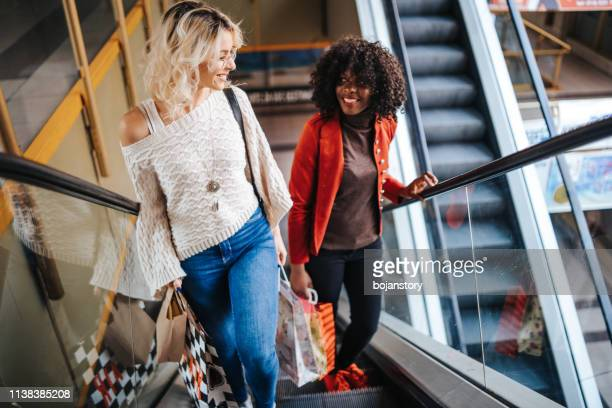 friends having fun in the shopping center - female friendship stock pictures, royalty-free photos & images