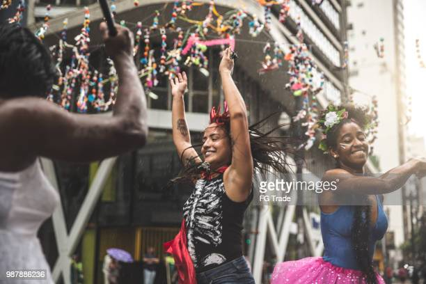 friends having fun on a carnaval celebration in brazil - carnival stock photos and pictures