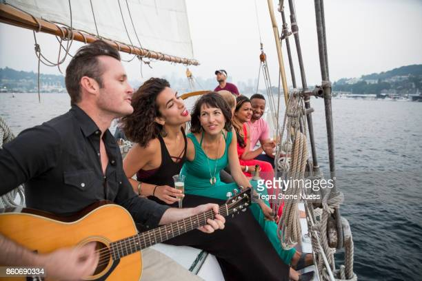 Friends having fun on a Sailboat