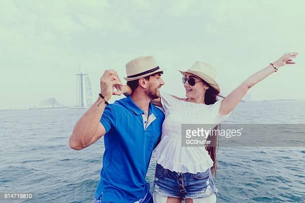 Friends having fun on a yacht in Dubai