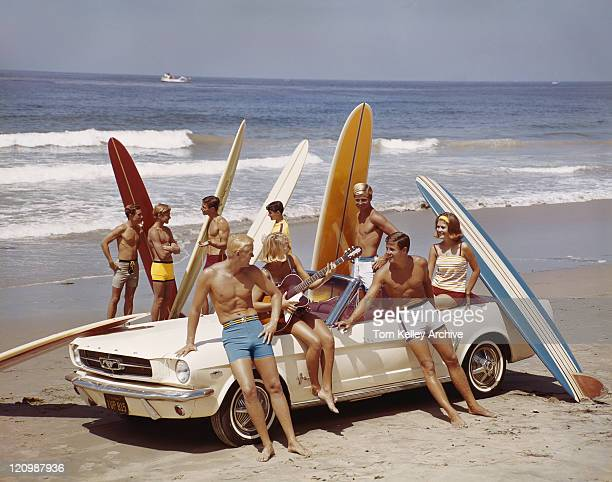 friends having fun on beach - archive stock pictures, royalty-free photos & images