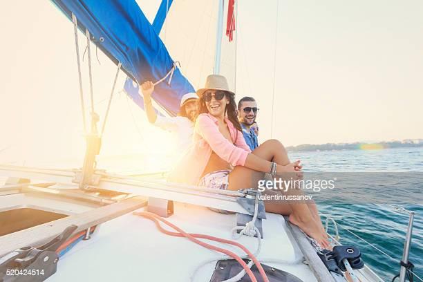 Friends having fun on sailboat.