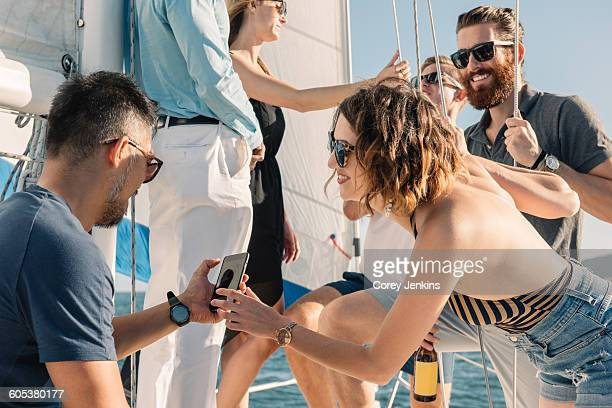 Friends having fun on sailboat