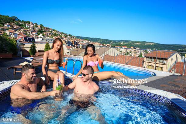 Friends having fun on swimming pool