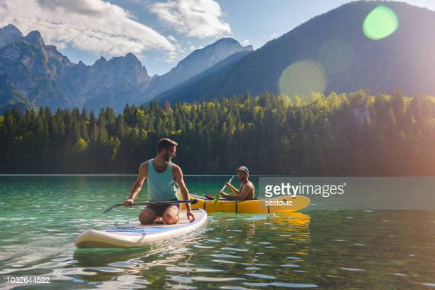 friends having fun on the lake - kayaking stock pictures, royalty-free photos & images