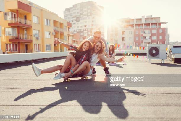 Friends having fun on the rooftop