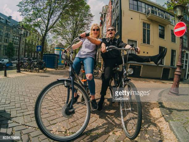 Friends Having Fun on their Bicycles in the City