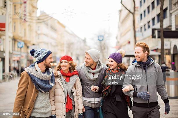 Friends having fun outdoors in winter city.