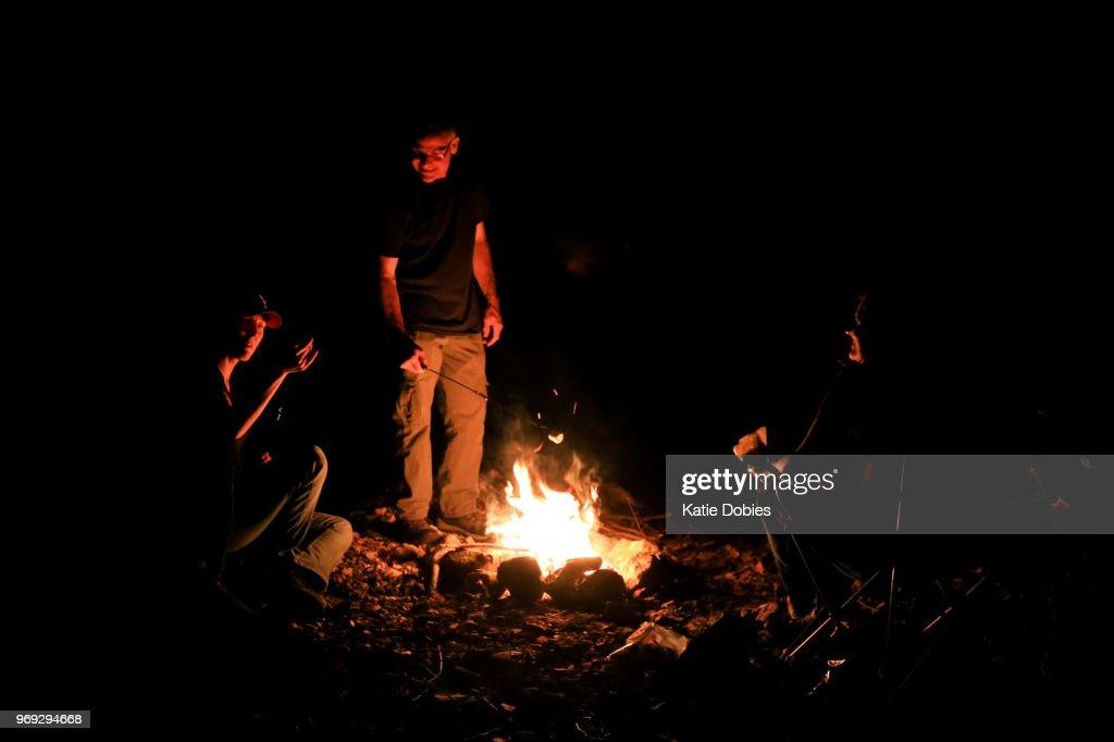 Friends Having Fun Roasting Marshmallows Over Campfire Stock Photo