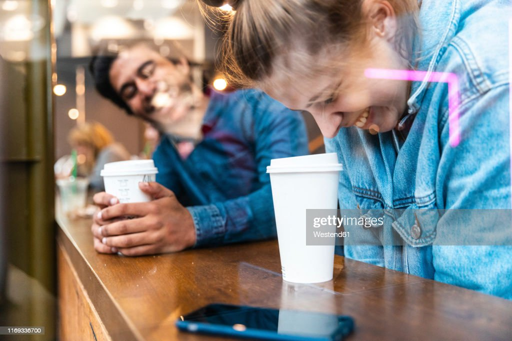 Friends having fun together in a coffee shop : Stock Photo